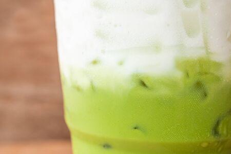 close up iced green macha tea wooden table Reklamní fotografie