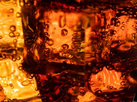 Cola With Ice And Bubbles In The Glass. Close Up Soda Soft Drink Фото со стока