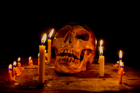 Skull with candles used in Halloween Horror Foto de archivo