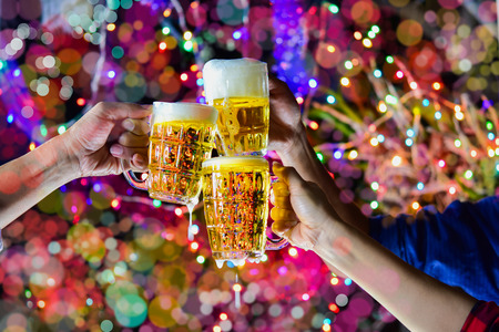Celebration with a beer mug background bokeh is a concept of celebration and social gatherings. Reklamní fotografie