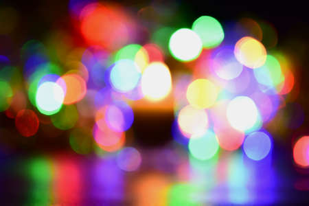 Spot color of bokeh light is abstract on multi-colored floor. Stock Photo
