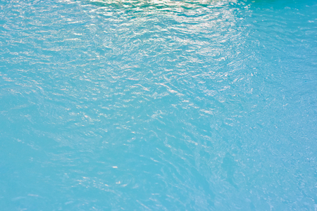 The image of the water in the blue swimming pool is suitable for use as a background and a background.