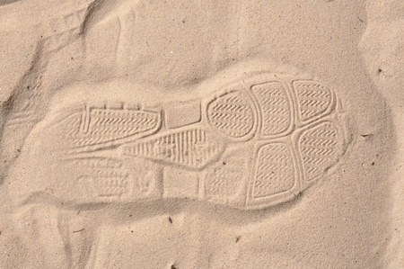 shoe foot print on sand photo