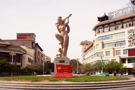 pipa: Center of Dunhuang city, landmark, bounce of Pipa JI Le sculpture