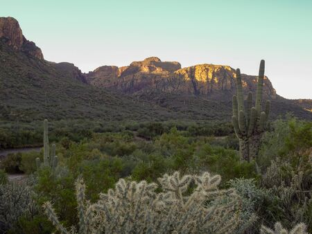 Sun peeking over the cliff in Tonto National Forest