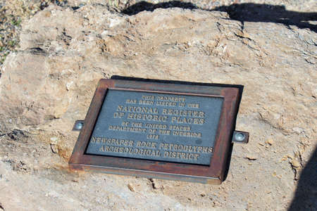 This is a plaque showing that Newspaper Rock has been listed on teh National Register of Historic Places