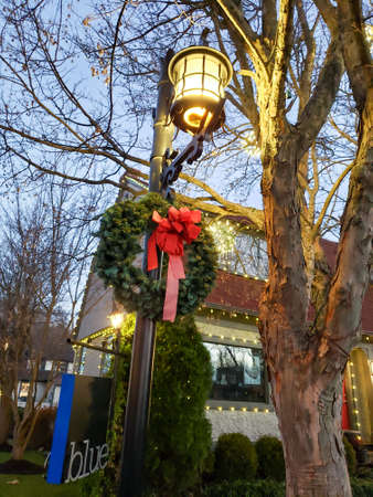 Beautiful Christmas Wreath hanging on a lamppost in Asheville, NC