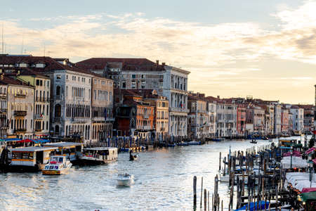 Views down the Grand Canal from the Rialto Bridge as the sun sets