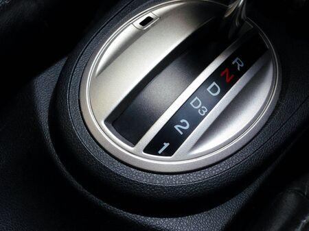 car park interior: Car interior. Automatic transmission gear shift