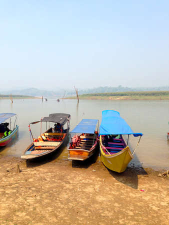 Fishing boat parking beside lake of Thailand Stock Photo