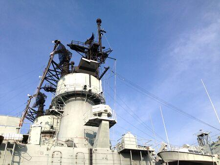 Radar on battleship with blue sky background