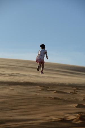 Young girl running in the desert