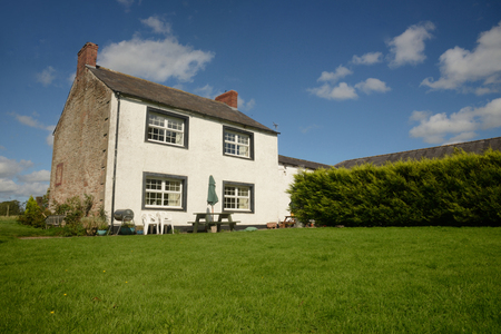 Country farm house with lawn photo