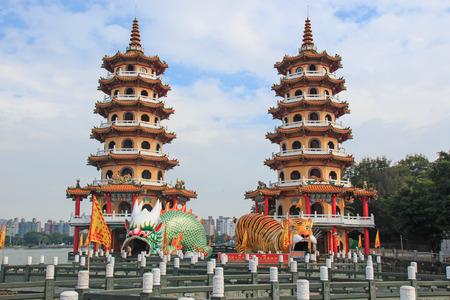 Kaohsiung, Taiwan - November 17,2014: Tourists at dragon And Tiger Pagodas at Lotus Pond, Kaohsiung, Taiwan