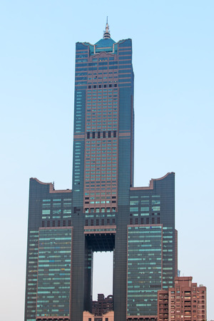 Kaohsiung, Taiwan - December 18,2014: Sunset over Tuntex Sky Tower. The structure is 378 m high. Constructed from 1994 to 1997, it is the tallest skyscraper in Kaohsiung, and was the tallest in Taiwan until the completion of Taipei 101.