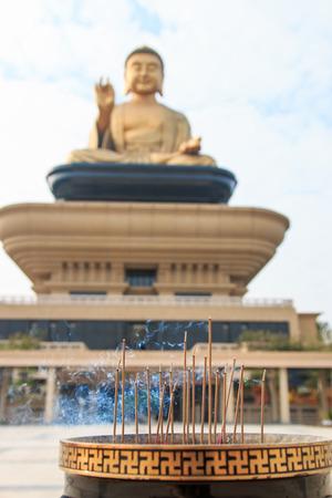 budda: Giant budda and incense at the Fo Guang Shan of Taiwan, Kaohiung Stock Photo
