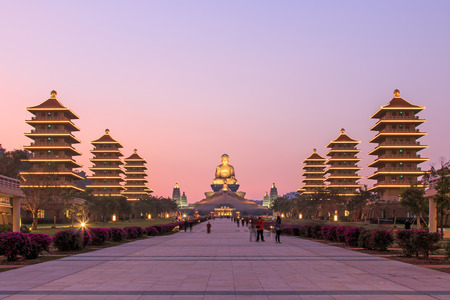 Sunset at Fo Guang Shan buddist temple of Kaohsiung, Taiwan with many tourists walking by.