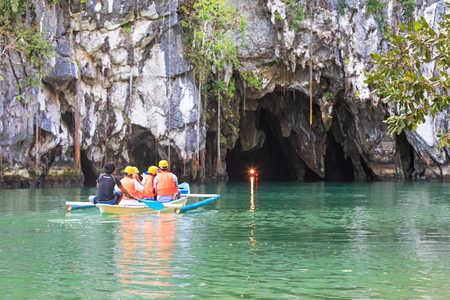 Puerto Princesa, Philippines - January 11, 2015: Visitors enter the Subterranean River in Puerto Princessa.The Underground River is one of the New 7 Wonders of Nature. Editorial