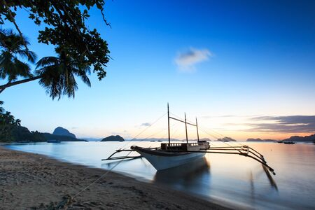 Sunset at Corong Corong beach, El Nido, Palawan in the Philippines photo