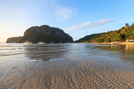 nido: Sunset at Corong Corong beach, El Nido, Palawan in the Philippines Stock Photo