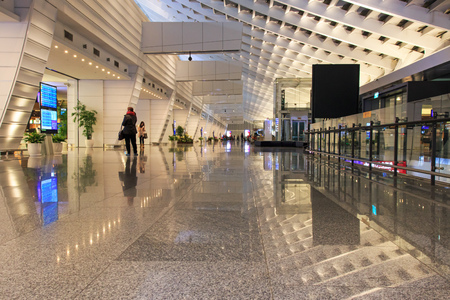Taipei, Taiwan - January 9, 2015: People inside the Taiwan Taoyuan International Airport, the busiest airport in the country and the main international hub for China Airlines and EVA Air.