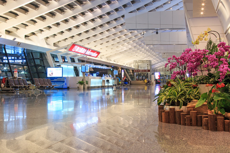 eva: Taipei, Taiwan - January 9, 2015: Interior of the Taiwan Taoyuan International Airport, the busiest airport in the country and the main international hub for China Airlines and EVA Air. Editorial