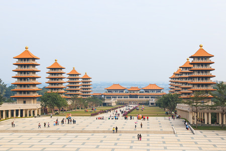 humanistic: Kaohsiung, Taiwan - December 15, 2014: Sunset at Fo Guang Shan buddist temple of Kaohsiung, Taiwan with many tourists walking by.