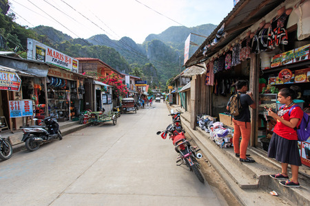 nido: El Nido, Palawan - January 16, 2015: main street of El Nido in Palawan, one of the main islands in the Philippines. Local people on foreground.