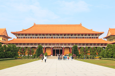 humanistic: Kaohsiung, Taiwan - December 15, 2014: Fo Guang Shan buddist temple of Kaohsiung, Taiwan with many tourists walking by.