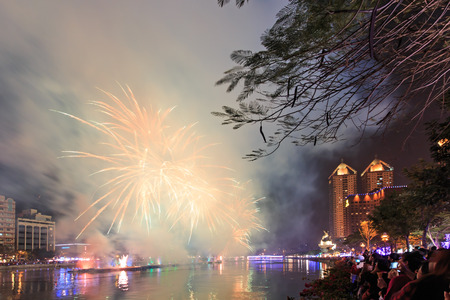 Kaohsiung, Taiwan, February 22, 2015: People watching the fireworks for the chinese new year at the Love River of Kaohsiung. The Chinese New Year is an important Chinese festival celebrated at the turn of the Chinese calendar. In China, it is also known a