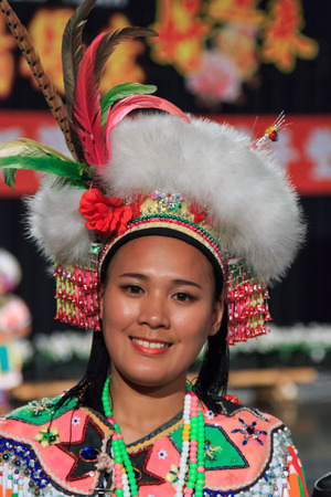 Pintung county, Taiwan - February 19,2015: Aboriginal Taiwanese woman in traditional attire at the Taiwan Indigenous People Cultural Park in Pintung county, Taiwan