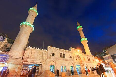 Amman, Jordan - March 22,2015: People walking in front of the Grand Husseini Mosque in downtown Amman. Redakční