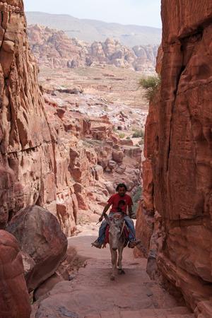 petra  jordan: Petra, Jordan - March 26, 2015: Local Jordanin guide exploring the ruins of ancient Petra, Jordan