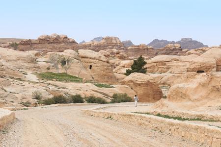 Petra, Jordan - March 26, 2015: Tourist exploring the ruins of ancient Petra, Jordan Editorial