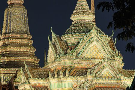 wat pho: Bangkok, Thailand - April 13, 2015: Wat Pho known also as the Temple of the Reclining Buddha at night Editorial
