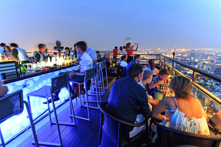 sky reflection: Bangkok, Thailand - April 15,2015: Bangkok by night viewed from a roof top bar