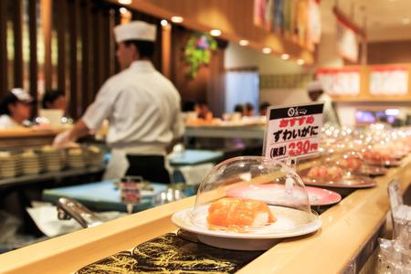 Otaru, Japan - July 9,2015: Japanese sushi restaurant with sushi on foreground