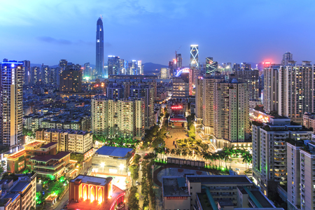 develope: Shenzhen, China - August 19,2015: Shenzhen skyline at twilight with the tallest building of the city on background: the Ping An IFC Editorial