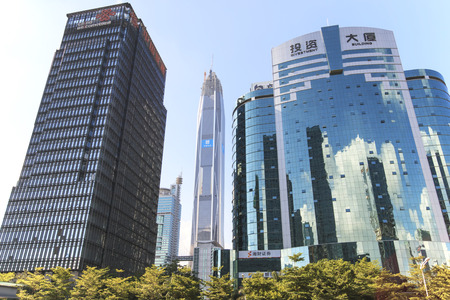 develope: Shenzhen, China - August 19,2015: Shenzhen skyline as seen from the Stock Exchange building with the Ping An IFC, the tallest building of the city, on background