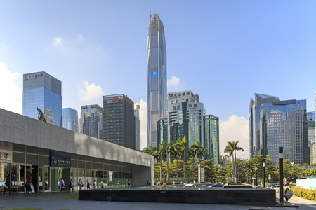 hing: Shenzhen, China - August 19,2015: Shenzhen skyline as seen from the Stock Exchange building with the Ping An IFC, the tallest building of the city, on background
