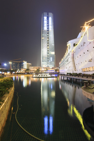 renamed: Shenzhen, China - August 22,2015: New Sea World Plaza, one of the landmark of Shenzhen, at night with the artificial lake on its center. The ship was originally known as Anceevilla and  was later renamed Minghua by the chinese who bought it.