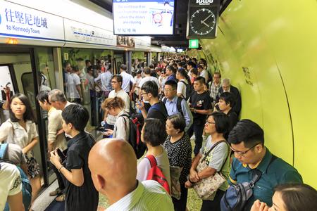 Kowloon, Hong Kong - August 14,2015: Commuters waiting for a train in the MTR Wan Chai in Hong Kong Redakční