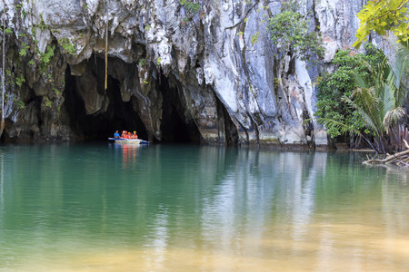Puerto Princesa, The Philippines - January 11,2015: Tourists on boat at the entrance of the Underground River, one of the new Seven Wonders of the nature