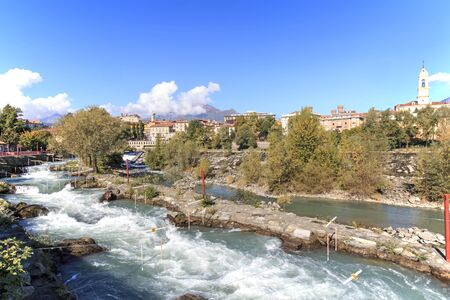 dora: Dora Baltea River and Ivrea cityscape in Piedmont, Italy Stock Photo