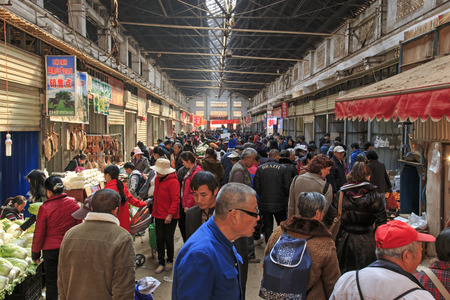 kunming: Kunming, China - January 9, 2016: People selling and buying in a traditional market in the center of Kunming