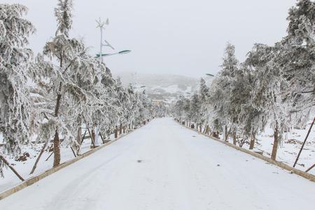 da: City center covered with snow in Da Shan Bao Yunnan Stock Photo