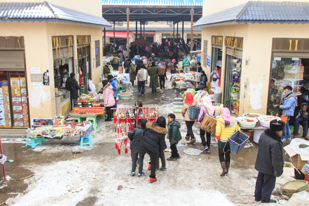 bao: Da Shan Bao, China - February 2, 2016: People selling and buying in a local market of Da Shan Bao Editorial