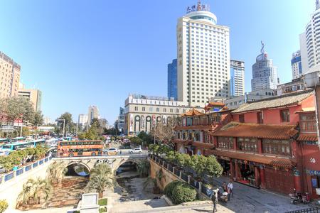 kunming: Kunming, China - January 12, 2016: Buildings in the city center of Kunming in China