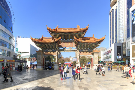 kunming: Kunming, China - January 12, 2016: Tourists walking in the city center of Kunming in China