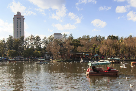 kunming: Kunming, China - January 8, 2016: Green lake park in Kunming, Yunnan, the most popular place for leisure in the city